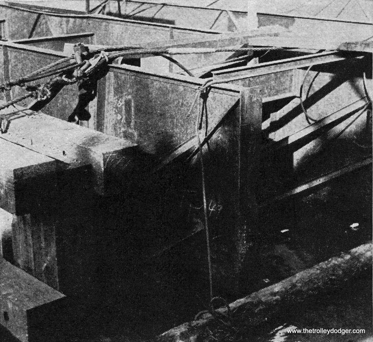 """From Engineering News-Record, November 2, 1939: """"Timber bulkheads sealed the tubes' mouths to make possible the 15-mi. voyage. afloat, the tubes were submerged 18 ft., with 5 ft., above the water. In plan, they measure 200 x 40 ft. Two stiffener ribs at the ends will connect the receiving cofferdam at the land ends of the subway."""""""