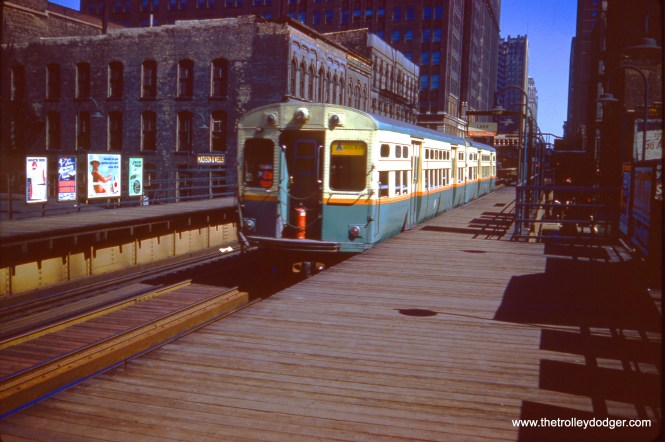 """A CTA two-car RAvenswood """"A"""" train at Madison and Wells on July 3, 1961. Note the fire extinguisher at the front of the train."""