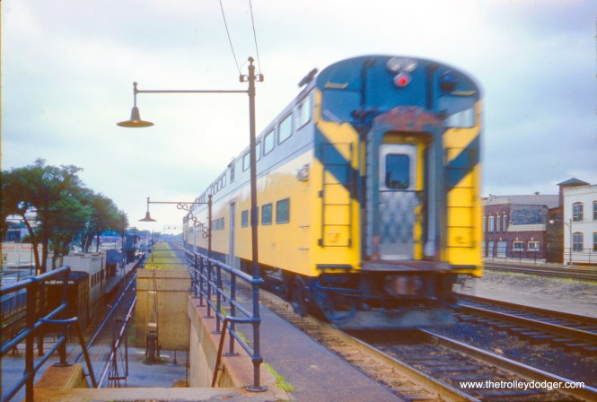 A Chicago & North Western commuter train at Oak Park, Illinois on July 2, 1961. The train is moving away from us, as these trains use left-hand running. Also to the left you can see the ground-level tracks of the CTA Lake Street 'L'. Just over a year later, those trains were relocated to the C&NW embankment. I assume the location is Marion Street here.