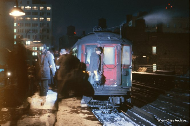 A truly historic photo that probably hasn't seen the light in 57 years. The late Charles L. Tauscher rode the last North Shore Line train ever, which ended its run at Roosevelt Road in the early morning hours of a very cold January 21, 1963. Motorman Bill Livings has just taken off the headlight and poses for a few pictures. This must be a long exposure (this was Ektachrome, and the film speed was 32) and you can see some motion blur on other parts of the platform. Truly the end of an era. (Wien-Criss Archive)