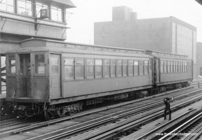 "A two-car Kenwood ""L"" train, including 2910, is in the stub at Indiana Avenue station on February 25, 1955."