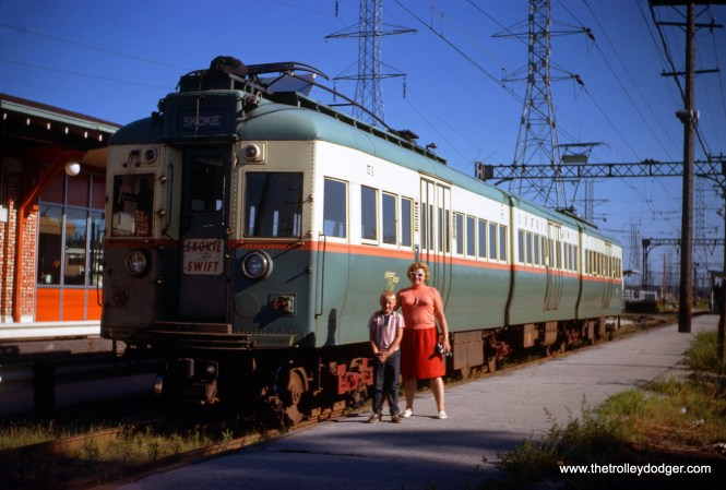 A family portrait by CTA articulated compartment car 51 at Dempster in Skokie in October 1968. This car was originally 5001 as delivered in 1947.