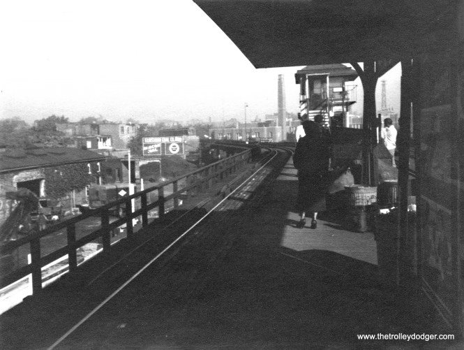 "We ran a lo-fi version of this picture in a previous post. The location at first was a real mystery, but turned out to be 42nd Place, the terminal of the CTA Kenwood branch, looking west. The next photo was taken further down the platform. (We ran originally ran this with other pictures that we saw on eBay, but hadn't been able to purchase. It was relisted and we decided to buy it after all.) Ross Harano adds, ""The view is looking north rather than west. The building with the chimney is Oakenwald Grammar School at 4071 S. Lake Park that I attended. The tower on the right is the ""Kiosk Sphinx"" that was on an estate just north of the grammar school. Geoffrey Baer had a segment on his WTTW's ""Ask Geoffrey"" about the wealthy family that built a Mediterranean style home with a pool and ""Eiffel"" tower. The property to the west of the station was owned by Nelson Coal. You can see the coal moving equipment in the photo. Nelson Coal stored mountains of coal east of the terminal tracks next to the Illinois Central Tracks. We used to play soldiers on the coal until we would be chased away by Nelson Coal workers."""