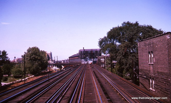 Approaching Wilson, looking north . in August 1963. Wilson shops are visible.