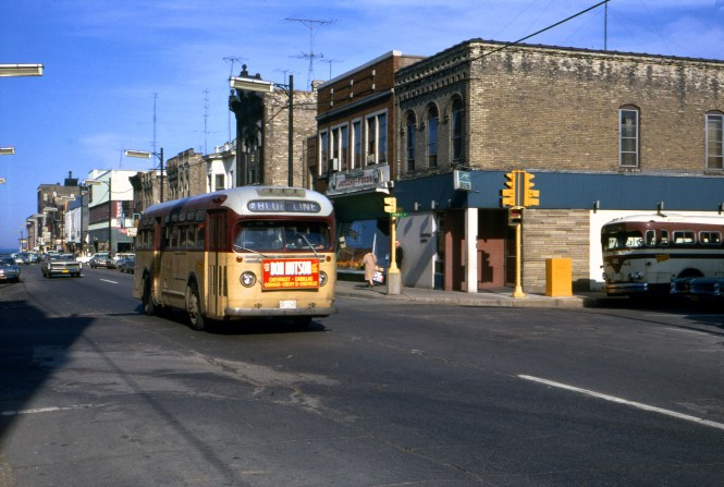 "Bill Shapotkin: ""This photo looks east on 6th Street across Park Avenue in Racine, WI. Note that the Greyhound station is located on S/E corner of intersection. Aside from Greyhound, Wisconsin Coach (which operates a suburban bus service between Milwaukee and Kenosha) also served this station."""