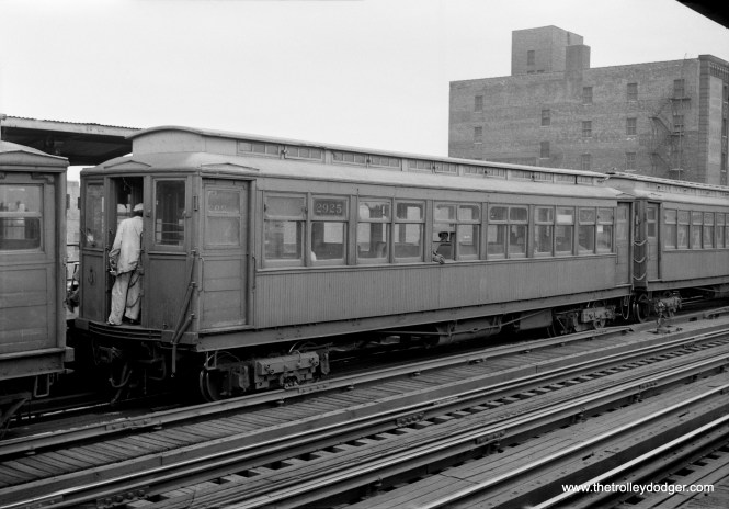 "From 1949 to 1957, the CTA operated the Kenwood branch of the ""L"" as a shuttle operation, and here we see three such cars at the Indiana Avenue station. By the mid-1950s, the older gate cars had been replaced by ones formerly used on the Met ""L"", as those lines were equipped with more modern steel cars. Not sure why there are three cars here-- Kenwood usually used one or two car trains in these days."