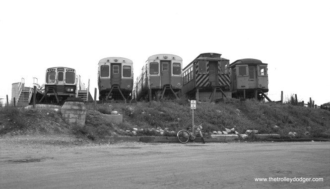 DesPlaines Avenue Yard in the 1960s, with a 2000, 6000s, and a couple of wood cars. The Met car looks like it has been converted to a snow plow, while the car on the right may have been used as an office or for storage.