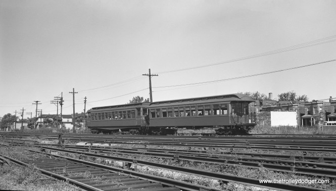 "A two-car Garfield Park ""L"" train, just west of Laramie Avenue in August 1948."