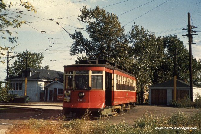 "CTA 129. M.E.: ""This scene has to be at the western end of the main 63rd St. line, at Narragansett and 63rd Place. The tight loop shown in the picture was built when one-ended PCC cars started running on 63rd. This picture had to be taken in 1952 or 1953 after the pre-war PCC cars were removed from 63rd and assigned to Cottage Grove. The last cars to run on 63rd were the old red Pullmans like this one."""