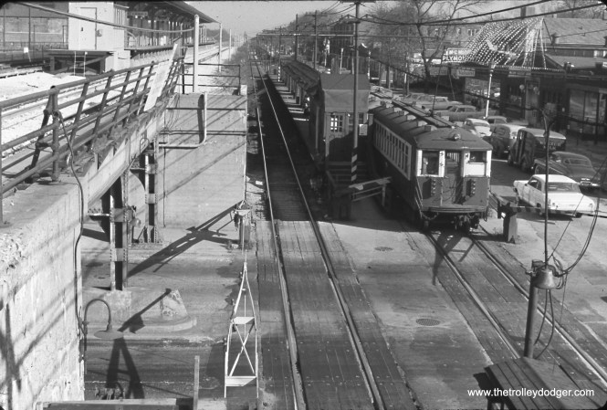 "The Lake Street ""L"" in 1962, looking east at Ridgeland. This must be just before the ""L"" was relocated to the Chicago & North Western embankment. M&C Motors, at right, was located at 315 South Boulevard."