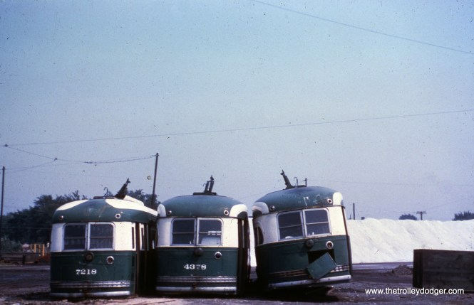 CTA 7218, 4378, and 4399 at South Shops in August 1959, more than a year after the last Chicago streetcar ran.