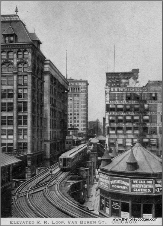 "We are looking west along the Van Buren leg of the Loop circa 1905. The train has a large ""S"" on it and is therefore a South Side ""L"" train, coming towards us as the Loop was left-hand running at the time, and is about to cross over to head south on the right-hand running Alley ""L""."