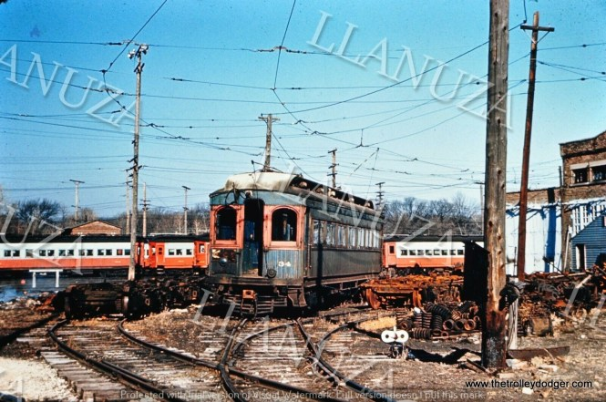 CA&E 34 and many others at the Wheaton yard in 1962, after abandonment of the railroad, but before the equipment was disposed of.