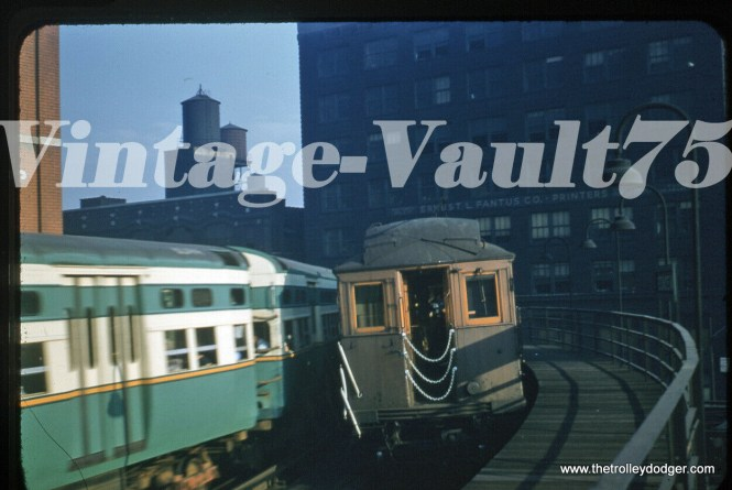 """Two """"L"""" trains pass at the Merchandise Mart station circa 1955."""