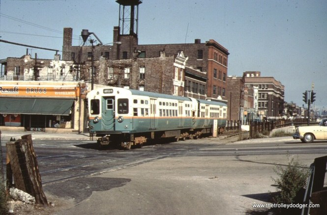 A CTA Garfield Park train heads west on Van Buren at Western. Streetcars crossed here until June 1956. Tracks are still evident, but I don't see any wire, so this could be after that.
