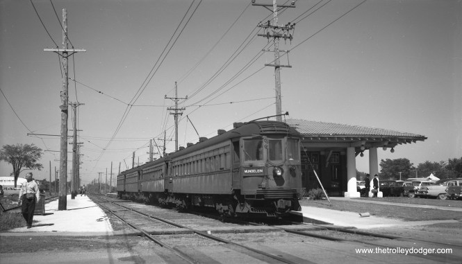"We have featured the work of photographer Richard H. Young before, going back to some of our earliest posts in 2015. Here, on June 2, 1960, we see a four-car North Shore Line train, headed up by car 175, at the Mundelein station. He notes, ""Train just arrived and standing on departure track but poles not reversed yet."""