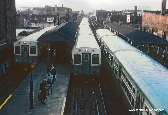 CTA (left to right) at Belmont Ave. Station, Ravenswood 2-car SB, B Jackson Park - Howard 6 car NB, A Englewood - Howard 6 car NB, in distance 2-car NB Ravenswood on April 9, 1966