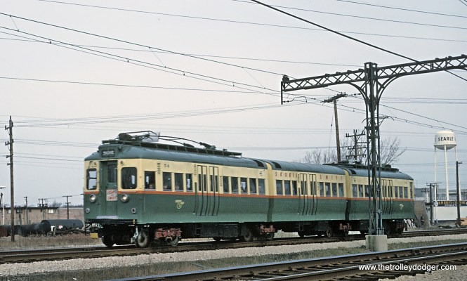 "These articulated cars were called ""jitterbugs"". There were only 4. Roger's photo is of CTA 54 as southbound Skokie Swift train south of Oakton St. in Skokie, IL on ex-CNS&M trackage on April 12, 1966. For more on these cars see: www.chicago-l.org/trains/roster/5000.html"