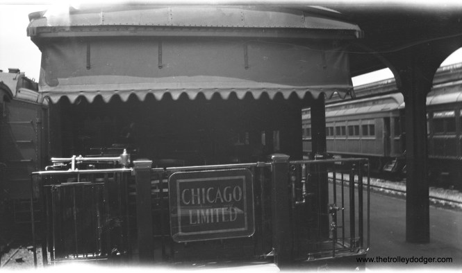 There must be a story behind this picture, showing an observation car on a mainline railroad. There were a number of lines that had a Chicago Limited.