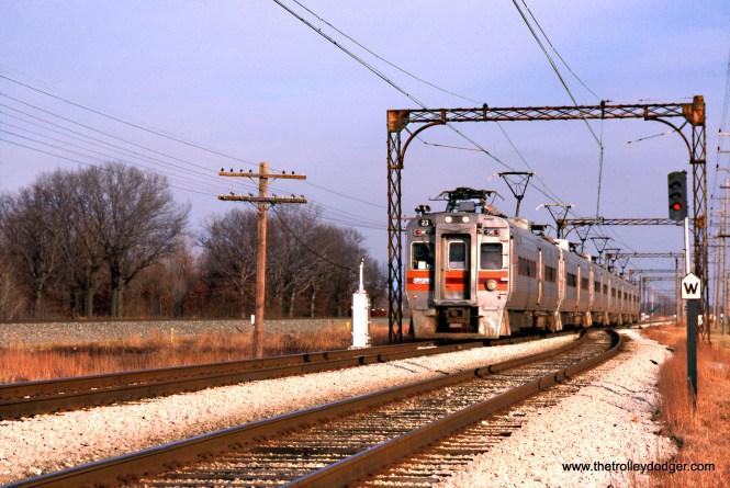 Chicago South Shore and South Bend 23 is at the head of a westbound train at Miller, Indiana on October 1, 1990. (Bill McCoy Photo, Wien-Criss Archive)