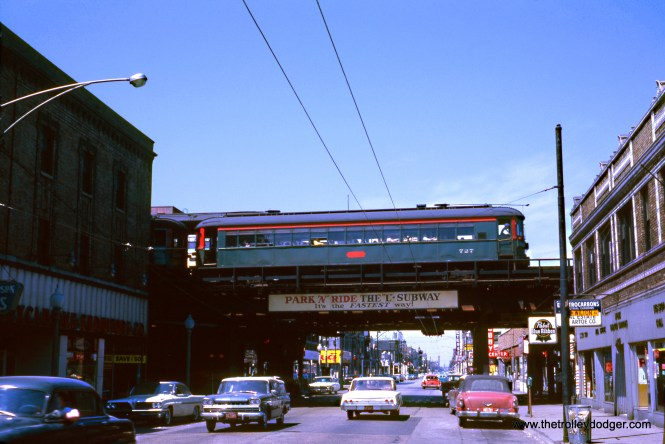 "North Shore Line 727 and 729 are northbound at Belmont on the CTA north side ""L"" on May 20, 1962. Don's Rail Photos: ""727 was built by Cincinnati Car Co in 1926, #2890. It was modernized in 1939 and sold to Iowa Chapter, National Railway Historical Society in 1963. It became Iowa Terminal RR 102 in 1967 and acquired by Iowa Trolley Museum in 1987. It was restored to some extent as CNS&M 727 and apparently returned to Iowa Terminal RR."" (Wien-Criss Archive) John Nicholson: ""Off to the right behind the ""L"" structure Benty Hobby Supplies was still a going concern. I remember it still being in operation into the early 1980s right around the time I moved into the Lake View neighborhood. Now hobby shops are becoming as scarce as interurbans."""