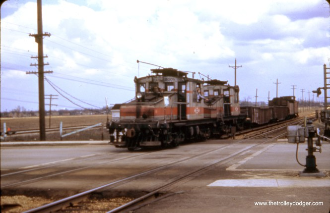 A CA&E freight train in Maywood. If that is correct, I would guess this is westbound crossing First Avenue, where the Illinois Prairie Path starts today. The tracks at left belong to the Chicago Great Western. The date is April 8, 1951.
