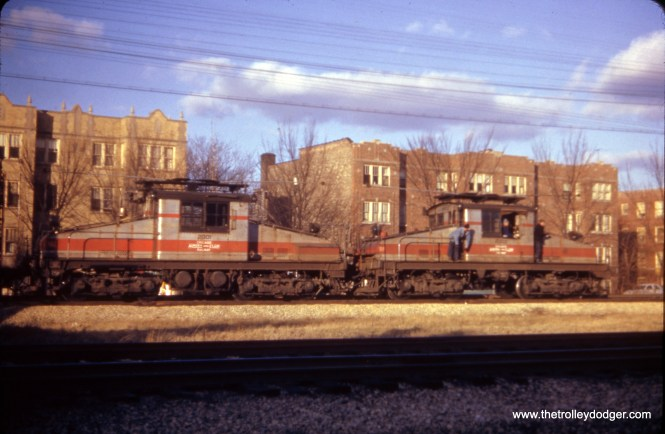 CA&E freight in Oak Park on November 18, 1951, with locos 2001 and 2002. In the background, you can see apartment buildings at around 600 Harrison Street. The Eisenhower Expressway runs here now, but the buildings seen still remain.