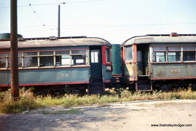 "North Shore Line cars 192 and 187 at Highwood in September 1963, looking much worse the wear, nine months after abandonment. But in actuality, these cars had been retired some years earlier. Don's Rail Photos: ""187 was built by Cincinnati Car in August 1920, (order) #2450. It was retired on December 31, 1955. It was scrapped at Rondout on January 29, 1964. 192 was built by Cincinnati Car in August 1920, #2450. It was retired on December 31, 1955. It was scrapped at Rondout on January 29, 1964."" Apparently these cars were considered surplus after the abandonment of the Shore Line Route in 1955."