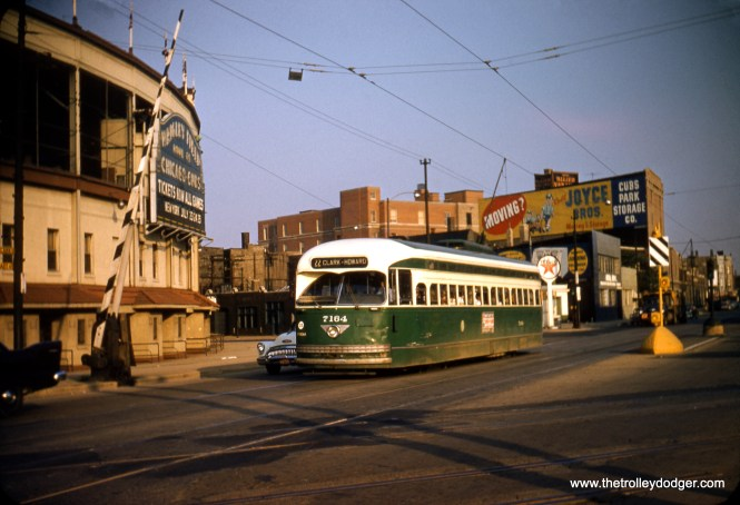 CTA 7164 is northbound on Clark at Addison in July 1957, crossing the Milwaukee Road tracks near Wrigley Field. A version of this photo, taken from a duplicate slide, appears on page 166 of B-146, incorrectly attributed to Charles L. Tauscher. (Robert Heinlein Photo)