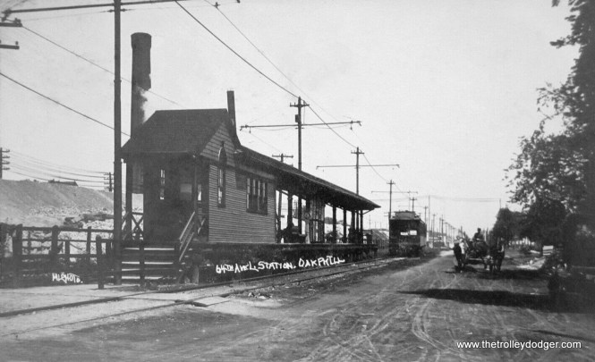 "This amazing real photo postcard sold on eBay for $77.89. I unfortunately was not aware of the auction. It shows the Ridgeland ""L"" station on South Boulevard in Oak Park. The postcard was mailed in 1909 and hence can't be any later than that. Work is already underway to elevate the Chicago & North Western tracks at left. The Lake Street ""L"" itself would join it on the embankment in 1962."