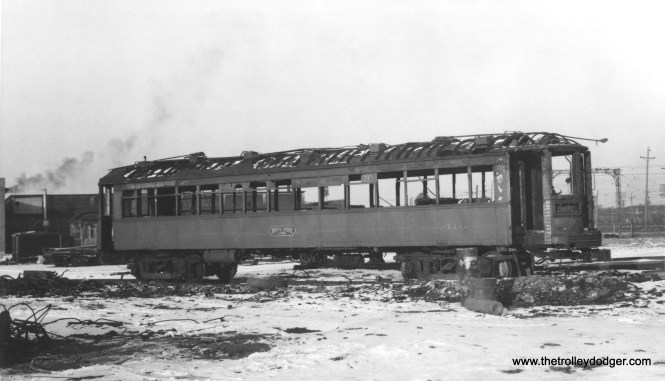 Photos showing North Shore Line trains being scrapped after the 1963 abandonment are rare-- and this is not one of them. This is car 416, built in 1916 by Cincinnati Car Company, and rebuilt in 1942. It was scrapped shortly after this picture was taken at North Chicago on January 21, 1956, after the car had been damaged in a fire.