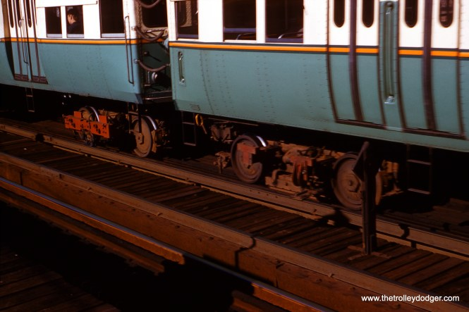 "Bill Hoffman took this picture on July 8, 1954, to compare ""old"" (left) and ""new"" types of third rail collection shoes on CTA 6000-series ""L"" cars. This photo was taken at 43rd Street."