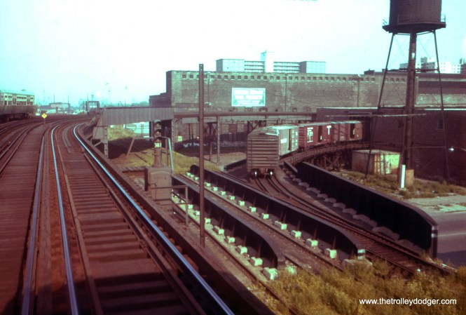 "The view looking west at 41st Street on the ""L"" as of June 28, 1962. The freight cars are on Chicago Junction Railway tracks. The old Stock Yards ""L"" branch would have run to the west just south of the CTA main line. East of here, the former Kenwood branch ran on CJR's embankment. The ""L"" turned north here via ""Powerhouse Curve."" (William C. Hoffman Photo)"