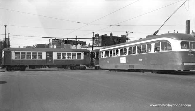 """We recently posted a color image, similar to this and taken at the same location, shot in 1955 by William C. Hoffman. This is most likely from the same general time period, as prewar PCC 7003 is running on Western Avenue. The prewar cars ran here from 1955-56 after they had been on the Cottage Grove line, converted to one-man operation. The """"L"""" train is running on the Garfield Park temporary trackage in Van Buren Street, which was used from 1953-58."""