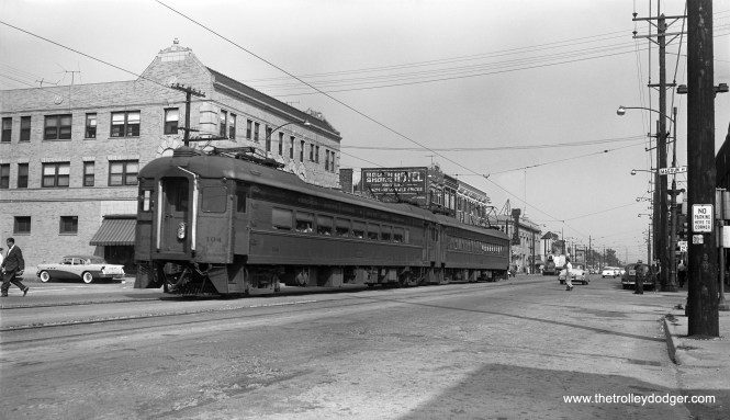 Another photo taken at the same location in East Chicago in 1956. Here, we see a westbound train on Chicago Street at Magoun Avenue.