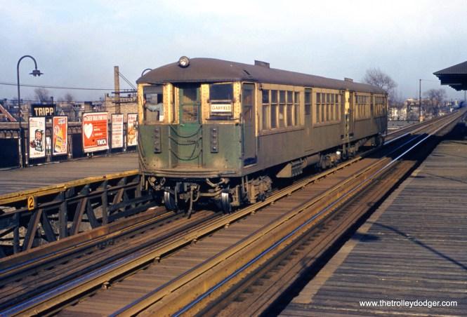 """A two-car CTA Garfield Park """"L"""" train stops at Tripp Avenue on March 11, 1956. This was one of the stations that was not in the way of expressway construction, and continued in service until June 21, 1958, when the new Congress rapid transit line opened. These cars were part of the first group of 4000s built by the Cincinnati Car Company circa 1915. The center doors were never used in service and were blocked off. The head car is 4238. (William C. Hoffman Photo)"""