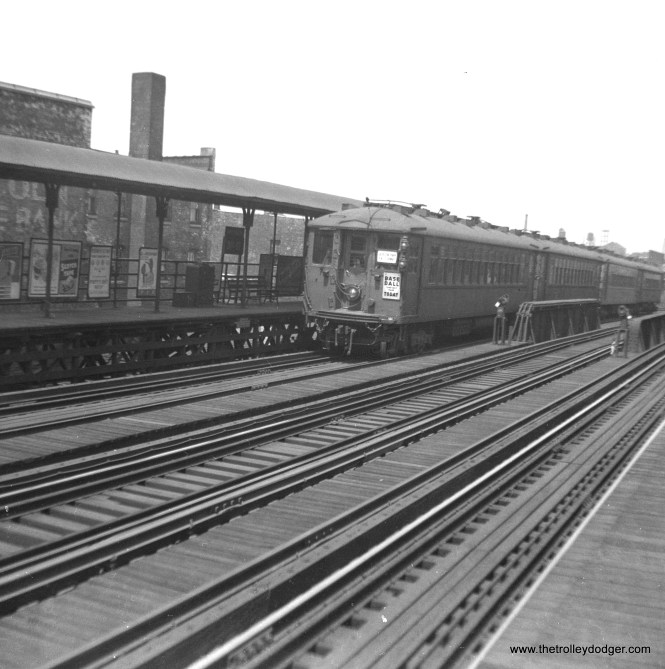 """A train of 4000s, signed for Jackson Park via the Subway, in 1947. If I am reading the sign correctly, this is 31st Street, a station the CTA closed in 1949. There was also apparently a Chicago White Sox home game when this picture was taken. M. E. writes: """"pict673.jpg features a Jackson Park train at 31st St. Notice three tracks. The middle track was used, although I am unsure under what circumstances. One possibility that comes to mind is that the Kenwood line (until it became a shuttle out of Indiana Ave.) ran on this trackage into the Loop and up to Wilson. The Kenwood was a local. The Englewood and Jackson Park trains sometimes bypassed the Kenwood locals using the middle track. There were switches up and down the line to enable moving to and from the middle track. Another possibility is that at one point the North Shore ran trains south as far as 63rd and Dorchester (1400 East) on the Jackson Park line. Perhaps some CNS&M trains used the middle track. One impossibility is that the Englewood and Jackson Park trains used the middle track the whole way from south of Indiana Ave. to the Loop. I say this was not possible because all the stations on this line were on the outer sides of the outside tracks. I don't recall any Englewood or Jackson Park trains running express on the middle track along this stretch. By the way, prior to the 1949 changes, only the Jackson Park line ran north to Howard. The Englewood ran to Ravenswood (to Lawrence and Kimball)."""""""