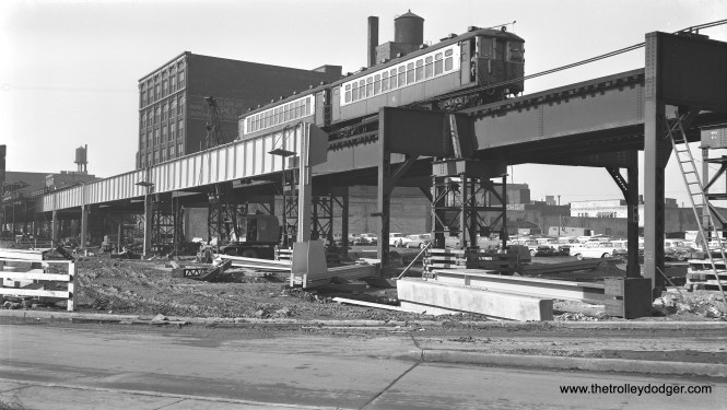 """A two-car train of 4000s is on the Lake Street """"L"""" during construction of the Northwest (now Kennedy) expressway on February 25, 1958. The new highway opened in 1960. Further south, the Garfield Park """"L"""" also crossed the highway footprint and had to be shored up around the same time this photo was taken. But once the new Congress rapid transit line opened on June 22, 1958 the Garfield line was no longer needed and the structure was removed where it crossed the highway, cutting the line off from the rest of the system. The remaining portions of structure west of there were removed in 1959; east of there, parts remained until 1964. The Lake Street """"L"""", on the other hand, rechristened the Green Line, is still here."""