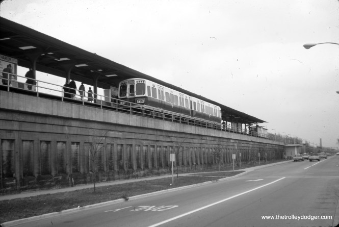 """A two-car train of CTA 2000s at Harlem Avenue on the Lake Street """"L"""" (today's Green Line) on November 11, 1966.  Until 1962, this line ran on the ground next to the Chicago & North Western embankment."""