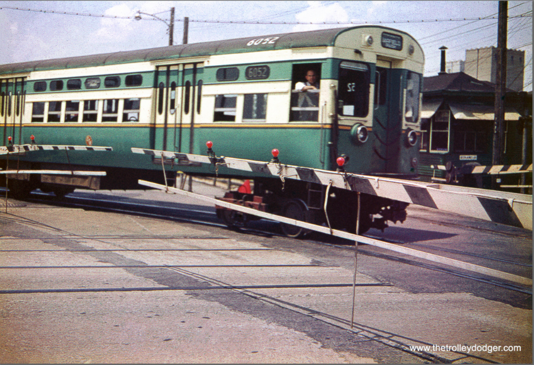 CTA 6052-6051 is eastbound, crossing DesPlaines Avenue in Forest Park in the 1950s. Some of the first CTA 6000s had numbers painted on their roofs for a while. The streetcar tracks had been used by the Chicago & West Towns Railway up until the 1940s. (William Shapotkin Collection)