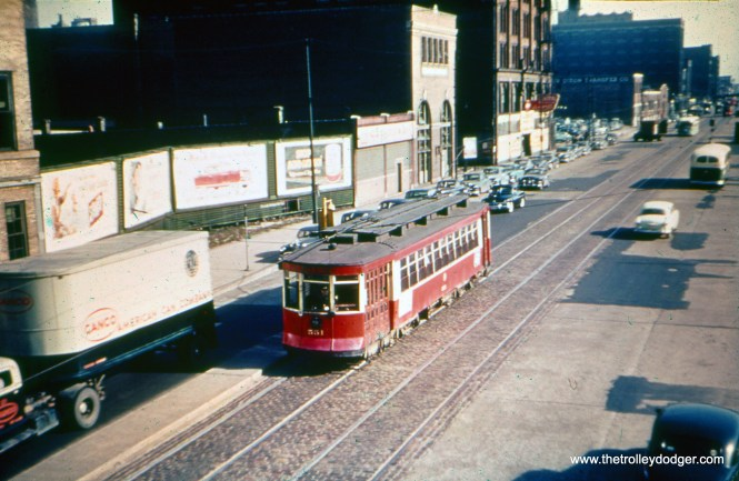 """CTA 551. Michael Franklin writes, """"This is looking south on State Street from Roosevelt Road. (The) building with round arches is still standing."""" (William Shapotkin Collection)"""