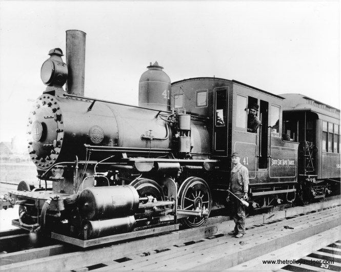 """Service on the South Side """"L"""" began under steam power, as seen here in this 1893 view of a train on 63rd Street just west of Cottage Grove. Locomotive #41 was built by Baldwin. Steam was replaced by electricity in the late 1890s. (Chicago Transit Authority Historical Collection)"""