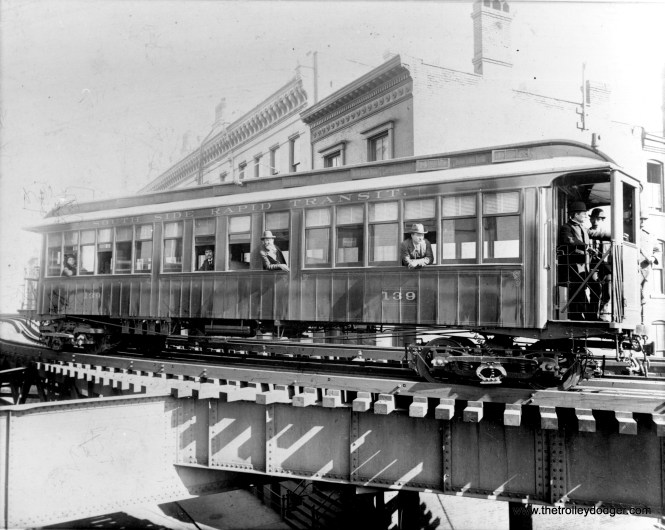 """Inventor Frank Julian Sprague was hired by the South Side """"L"""" to equip their cars with electricity (powered by third rail) and multiple unit operation, his latest invention. Here, """"L"""" car 139 is being tested on Harrison Curve on April 16, 1898. (Chicago Transit Authority Historical Collection)"""
