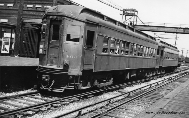 """Chicago Aurora & Elgin car 403 at Laramie Avenue on July 19, 1933. It was described as """"red with gold trim."""" 403 was a Pullman product, built in 1923. Sister car 409 is at the Illinois Railway Museum. The view looks to the northeast."""