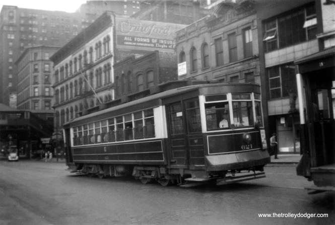 CSL Pullman 621, signed for Clark and Devon, is apparently running on Route 22 and headed north on Clark, having just passed Lake Street in this circa 1940 scene. The Shreve Building, built in 1875, was located at the northwest corner of Clark and Lake. Its construction was supervised by William Warren Boyington (1818-1898), who designed the landmark Chicago Water Tower. Not sure when it was demolished.