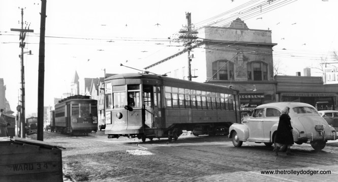"""CSL 498 and 3085. I am unable to see the route signs, but at least we can tell this picture was taken in the 34th Ward. 498 is signed to go to North Western Station, which was a sign used on Milwaukee Avenue cars. Michael Franklin says we are """"looking at the NW corner of Armitage & California."""""""