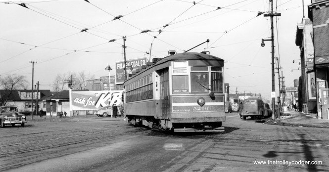 """CSL 3216 is signed for 51st and Central Park. M. E. writes: """"Given that the destination sign reads """"51 - Central Park"""", then this picture was taken from the northwest corner of 51st and Cottage Grove Ave., looking south. The 51st St. line's eastern terminal was actually at 55th St. and the Illinois Central railroad at Lake Park Ave. From there, the route headed west on 55th to Cottage Grove Ave., north to 51st St., and west on 51st St. So the car in this picture is making the turn from northbound Cottage Grove to westbound 51st."""" On the other hand, Graham Garfield writes, """"Note the sign on the light pole that says """"4A"""". Illinois route 4A was a state highway from Joliet to downtown Chicago via Archer Ave. until 1967. Based on buildings in the background that are still extant, the angled street here is Archer and the car is deadheading from Archer carbarn (where the #51 was out of) to 51st St to start its run. We are looking northeast at Archer/Kedzie."""""""