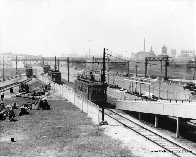 The Chicago Surface Lines tracks were extended to the site of A Century of Progress in 1933. This could be from that year, as a shelter is under construction. We are looking south.