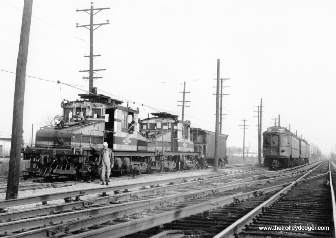A CA&E freight train is on a siding while a regular train passes.