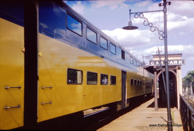 A westbound C&NW commuter train stops in Oak Park in July 1960. (William Shapotkin Collection)